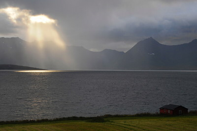 Sun rays over a fjord