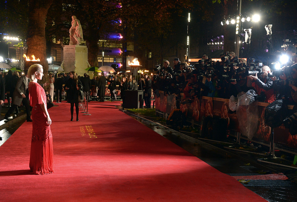 . American actress Jena Malone poses for photographers as she arrives on the red carpet for the World Premiere of \'The Hunger Games: Catching Fire\', on Monday Nov. 11, 2013 in Leicester Square, London. \'Catching Fire\' is the second installment in \'The Hunger Games\' trilogy. (Photo by Jon Furniss/Invision/AP)