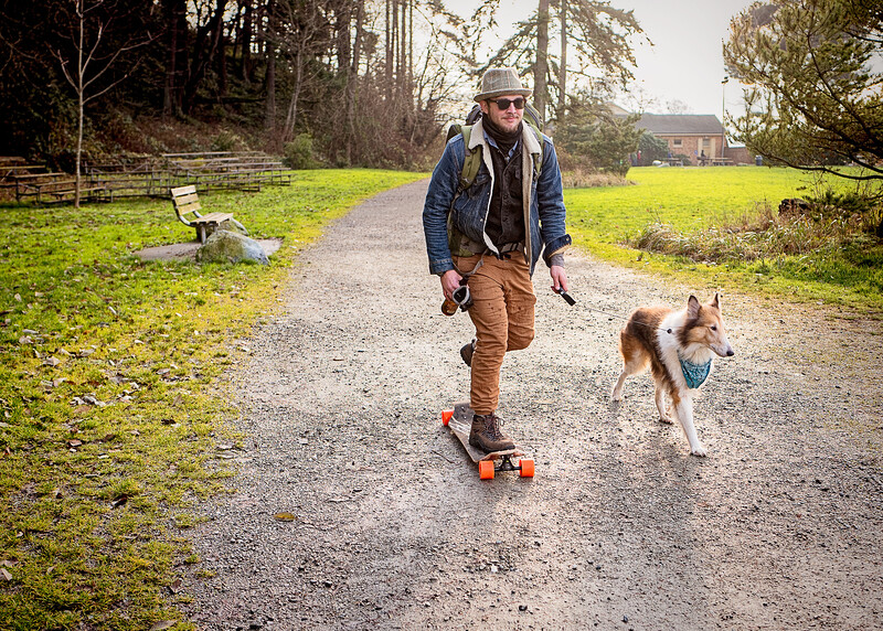 Have beer and dog, must ride skateboard
