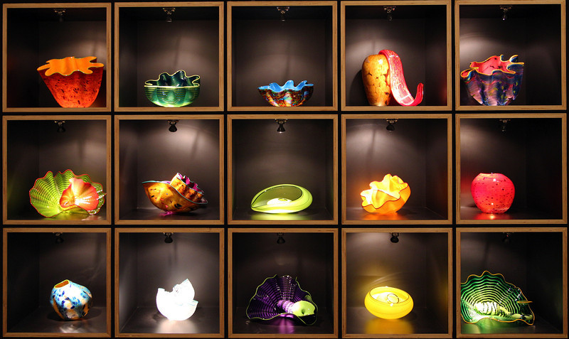 A cabinet of Chihuly glass objects.