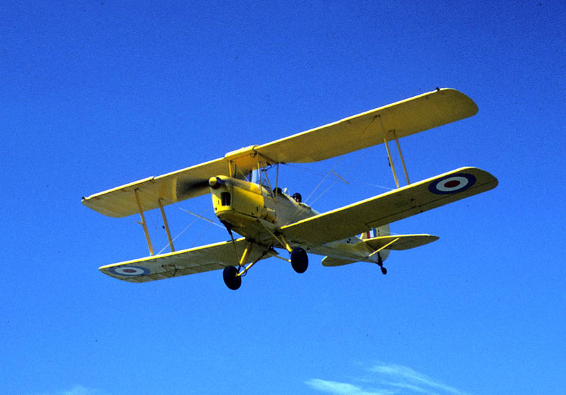 De HAVILLAND D.H.82 TIGER MOTH Santa Paula Airport - May 1975  Here's Don and his friend on final approach. The really nice thing about photographing airplanes at Santa Paula Airport was the great vantage point at the very end of the runway -- that and the place was usually swarming with antique airplanes.