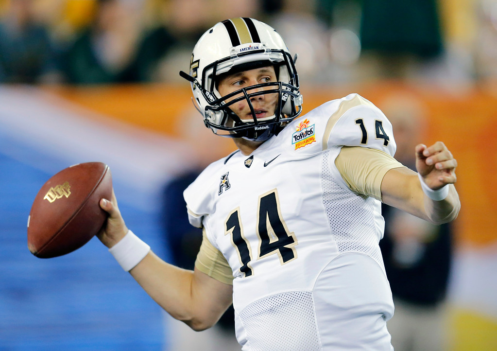 . CORRECTS TO PETE DINOVO, INSTEAD OF BLAKE PORTLES - Central Florida quarterback Pete DiNovo warms up prior to the Fiesta Bowl NCAA college football game against Baylor, Wednesday, Jan. 1, 2014, in Glendale, Ariz.  (AP Photo/Matt York)