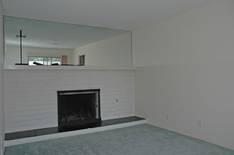 Wood burning fireplace located in the family room.