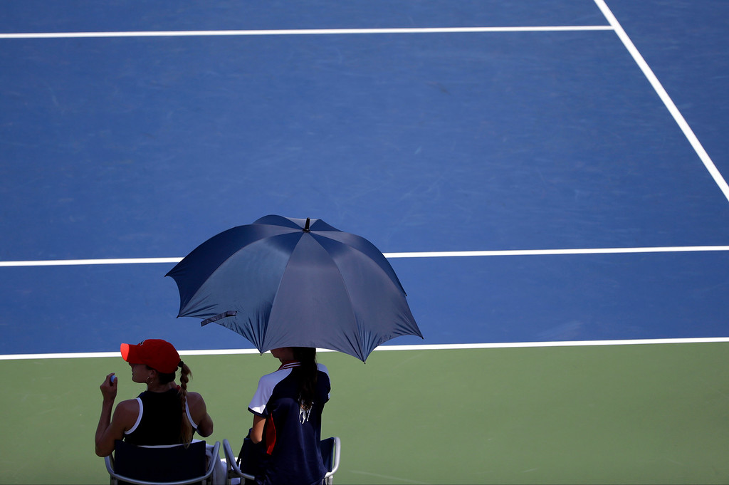 . Alize Cornet, of France, takes a break during a first round match against Portugal\'s Maria Joao Koehler at the 2013 U.S. Open tennis tournament Tuesday, Aug. 27, 2013, in New York. (AP Photo/David Goldman)