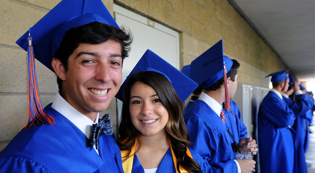 . Kevin Lewallyn and Kirsten Mancini pose for a photograph before the ceremony.  Chaminade College Preparatory High School, celebrating its 60th anniversary, graduated 337 students at the West Hills campus on Saturday, June 01, 2013.  (Dean Musgrove/Los Angeles Daily News)