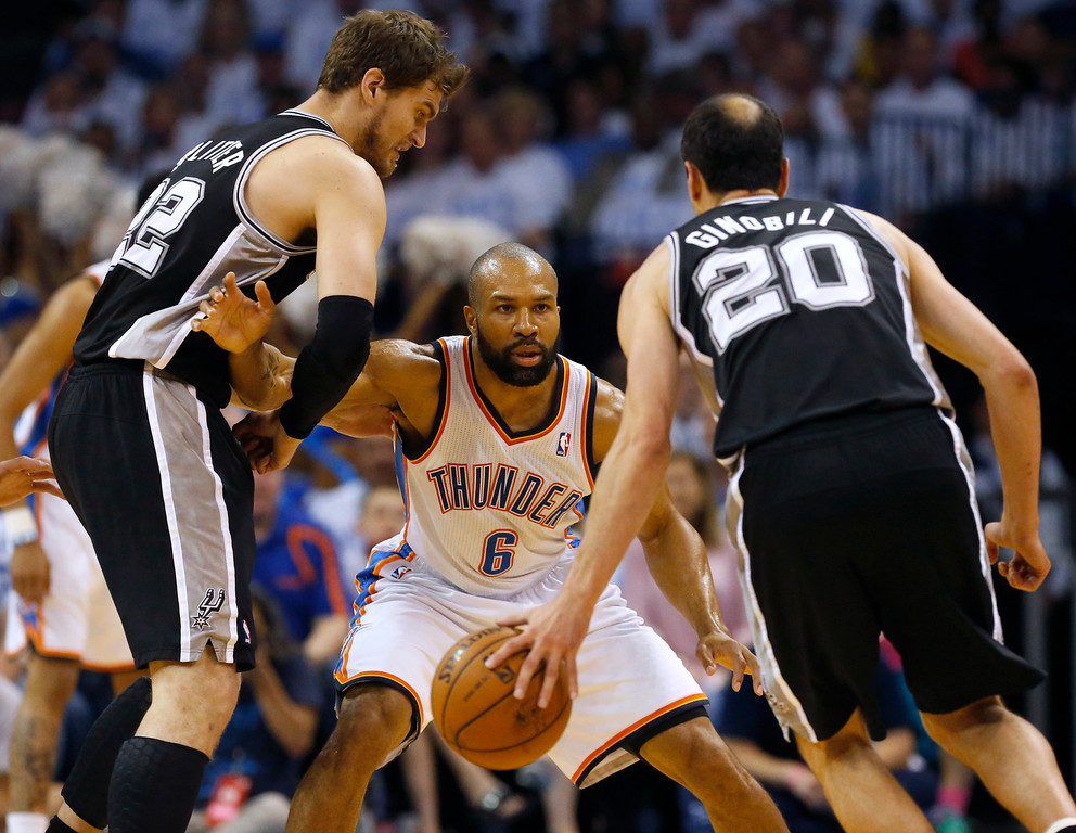 . Oklahoma City Thunder guard Derek Fisher (6) defends between San Antonio Spurs guard Manu Ginobili (20) and Tiago Splitter during the first half of Game 6 of the Western Conference finals NBA basketball playoff series ,in Oklahoma City, Saturday, May 31, 2014. (AP Photo/Sue Ogrocki)
