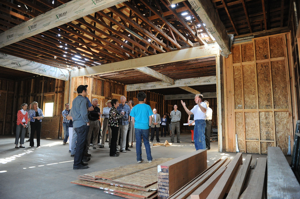 . (John Valenzuela/Staff Photographer) A crowd gathers inside the renovated Barton School House in Redlands during an open house for first phase completion of the school, Friday, May 24, 2013.  Contractor Roger Smart and Architect Shan McNaughton have worked together to resurrect the historic school house.