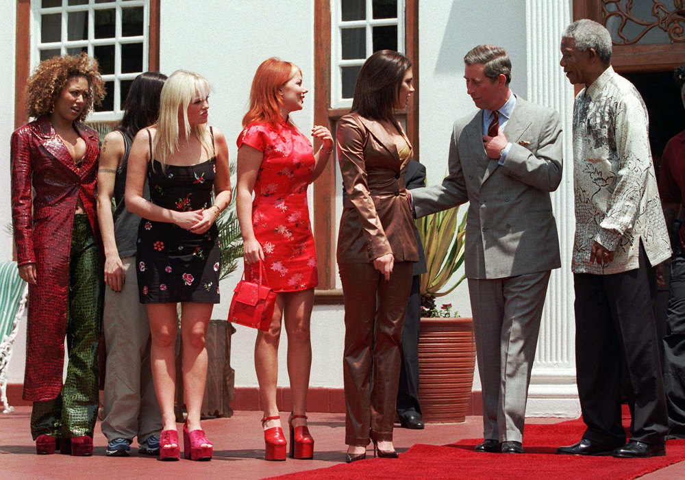 Description of . Members of the British pop group the Spice Girls, left to right, Mel B, Mel C, Emma, Geri and Victoria, meet with Britain's Prince Charles, second right, and South African President Nelson Mandela, right, in Pretoria Saturday, November 1, 1997. Prince Charles will attend a pop concert in Johannesburg with his son Prince Harry later Saturday to watch the Spice Girls perform. (AP Photo / Adil Bradlow)