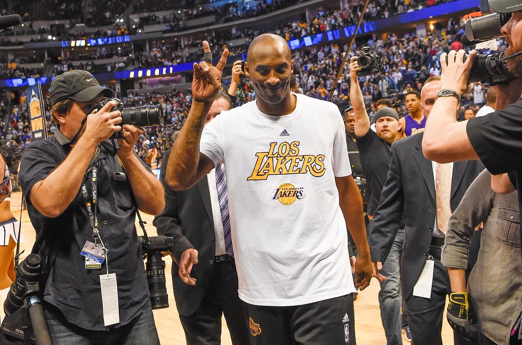 . DENVER, CO - MARCH 02: Los Angeles Lakers forward Kobe Bryant (24) gives the peace sign as he leaves the court after the Los Angeles Lakers loss to the Denver Nuggets 117-107 March 2, 2016 at Pepsi Center. Kobe Bryant retires at the end of the season. (Photo By John Leyba/The Denver Post)