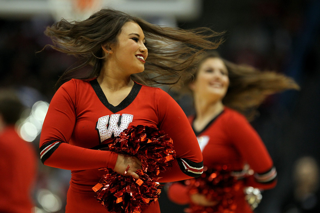 . Wisconsin Badgers cheerleaders perform against the Oregon Ducks during the third round of the 2014 NCAA Men\'s Basketball Tournament at BMO Harris Bradley Center on March 22, 2014 in Milwaukee, Wisconsin.  (Photo by Mike McGinnis/Getty Images)