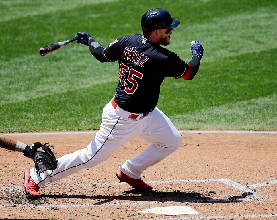 . Cleveland Indians\' Roberto Perez hits an RBI-single off Chicago White Sox starting pitcher Jose Quintana in the second inning of a baseball game, Sunday, June 11, 2017, in Cleveland. Edwin Encarnacion scored on the play. The Indians won 4-2. (AP Photo/Tony Dejak)