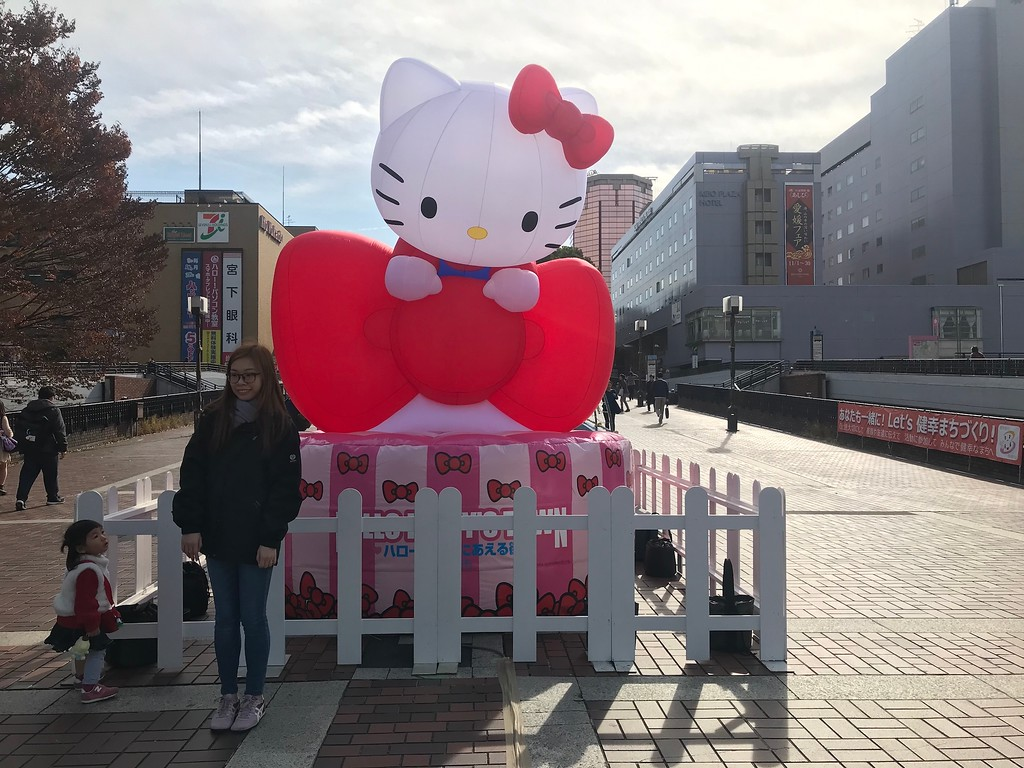 You'll pass a large Hello Kitty figure.