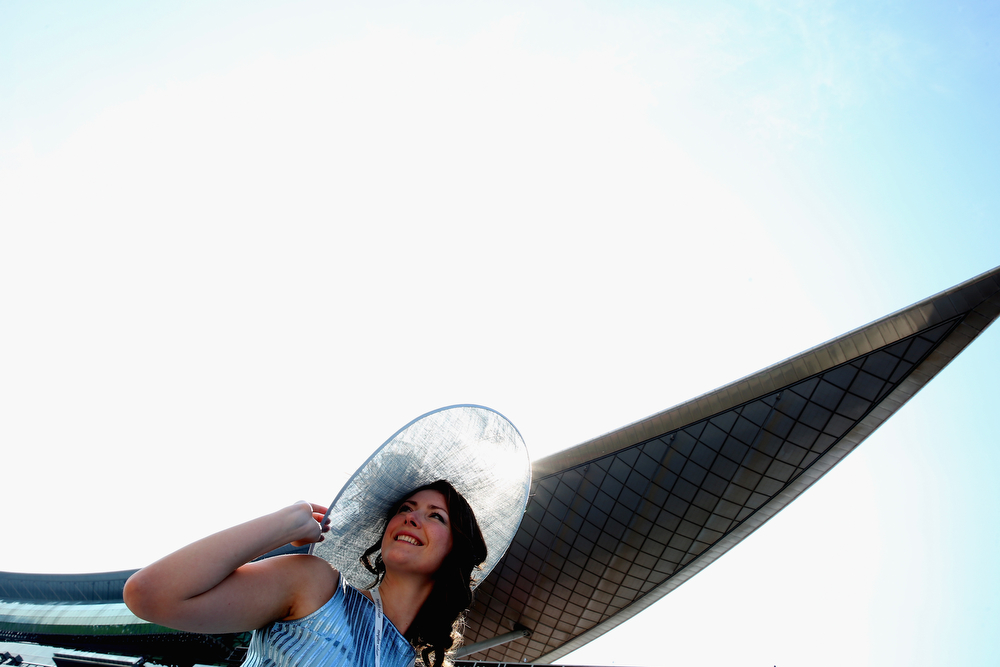. MARCH 29:  Race goers are pictured during the Dubai World Cup at the Meydan Racecourse on March 29, 2014 in Dubai, United Arab Emirates.  (Photo by Warren Little/Getty Images)