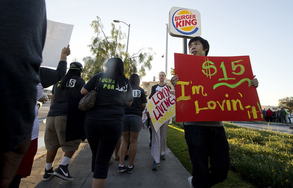 . Fast food workers and their supporters picket outside a Burger King restaurant in Los Angeles on August 29, 2013.    AFP PHOTO / Robyn BECK/AFP/Getty Images