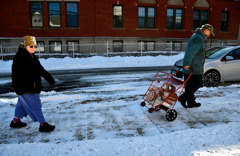 1/30/2019 Mike Orazzi | Staff Patricia and Dave Talbot with food pantry items they received from the Bristol Salvation Army on Stearns Street on Wednesday.