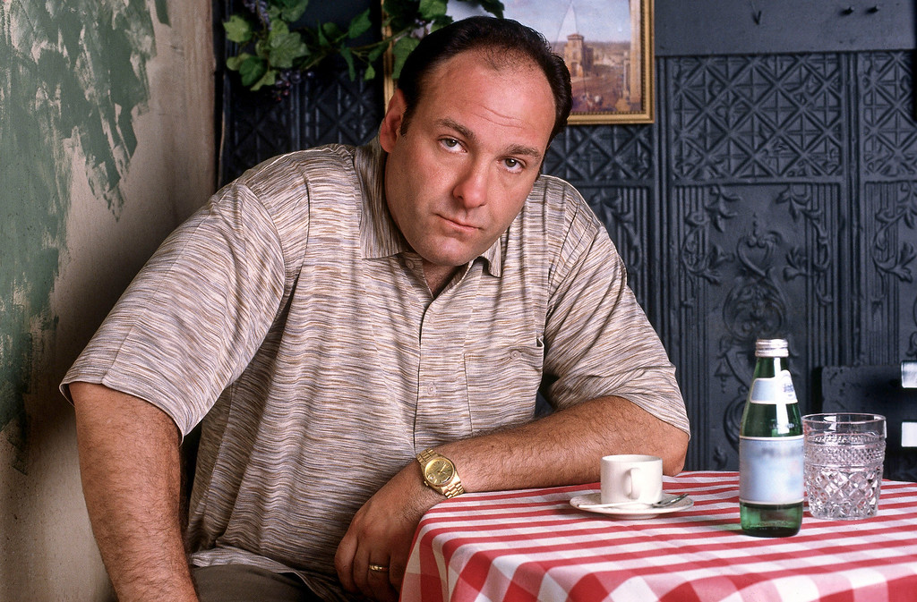 """. This 1999 file photo provided by HBO, shows James Gandolfini as mob boss Tony Soprano, in an episode from the first season of the HBO cable television mob series, \""""The Sopranos.\"""" HBO and the managers for Gandolfini say the actor died Wednesday, June 19, 2013, in Italy. He was 51. (AP Photo/HBO, Anthony Neste, File)"""