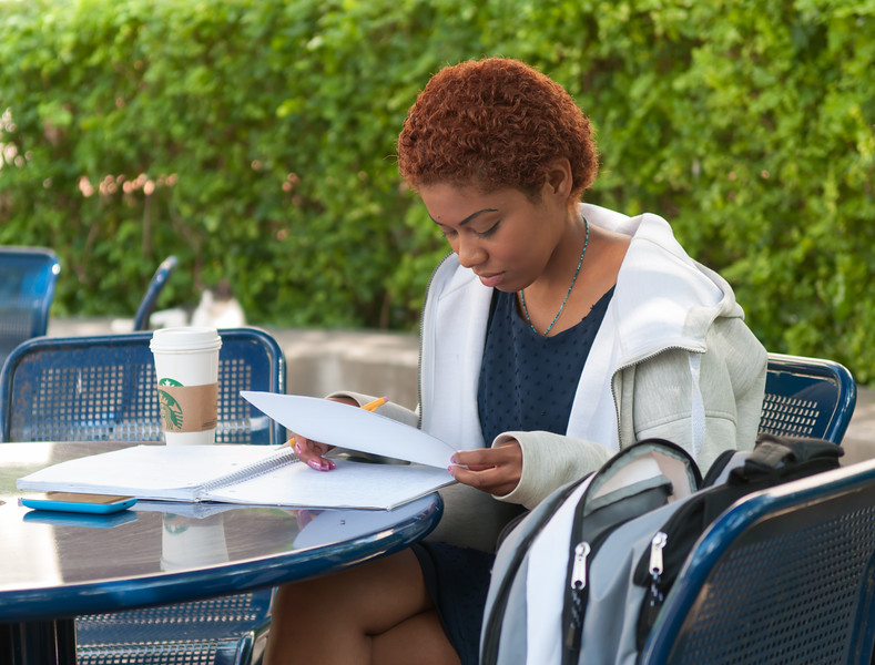 Student Marivel Salazar takes advantage of the nice weather to study outdoors in the Hector P Garcia plaza on campus.