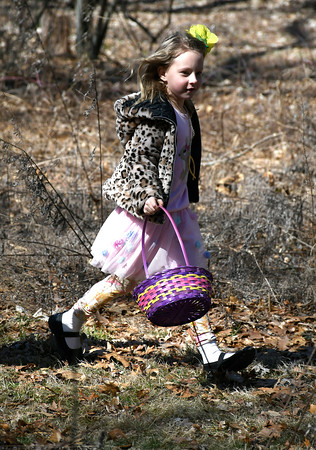 3/31/2018 Mike Orazzi | Staff Kylie Janik looks for Easter eggs during the Easter Eggstravanganza at the Hungerford Park Nature Center in Kensington Saturday.