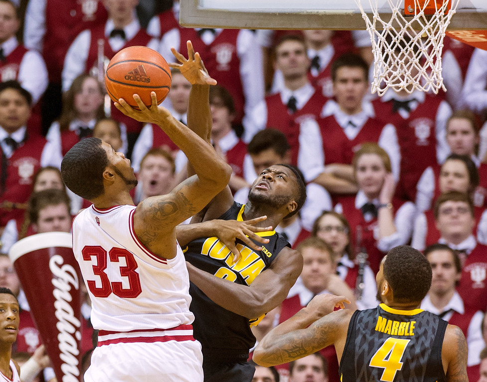 . Iowa\'s Gabriel Olaseni (0) tries to block the shot of Indiana\'s Jeremy Hollowell (33) in the first half of an NCAA college basketball game on Thursday, Feb. 27, 2014, in Bloomington, Ind. (AP Photo/Doug McSchooler)