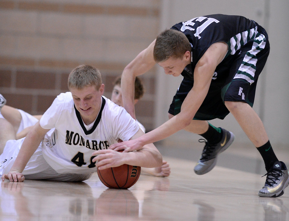 . Sawyer Novak of Fossil Ridge High School (13), right, steals the ball from Ryan Webbd of Monarch High School (40) in the 2nd half of the game.   (Photo by Hyoung Chang/The Denver Post)