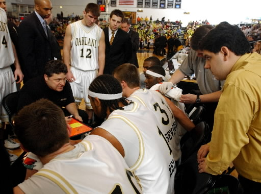 . Oakland University student manager Anthony Taormina, right, listens in on basketball head coach Greg Kampe, as Kampe was giving instructions to his team during a timeout.  Photo taken on Saturday, February 10, 2007, at the Athletics Center in Rochester Hills, Mich.  Oakland beat Valparaiso, 64-61.  (The Oakland Press/Jose Juarez)