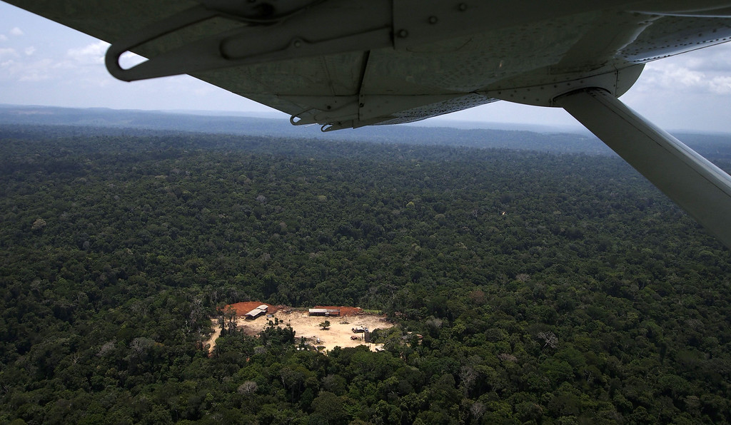 """. View of the so called Odami sawmill during an overflight by Greenpeace activists over areas of illegal exploitation of timber, as part of the second stage of the \""""The Amazon\'s Silent Crisis\"""" report, in the state of Para, Brazil, on October 14, 2014. RAPHAEL ALVES/AFP/Getty Images"""
