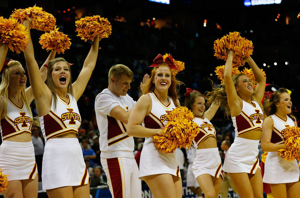 . Iowa State Cyclones cheerleaders perform during the third round of the 2014 NCAA Men\'s Basketball Tournament against the North Carolina Tar Heels at the AT&T Center on March 23, 2014 in San Antonio, Texas.  (Photo by Tom Pennington/Getty Images)