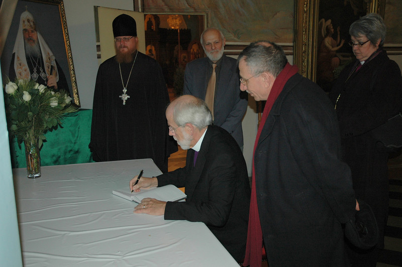 ELCA Presiding Bishop Mark Hanson signs a book of condolences Jan. 13 in Jerusalem, in memory of His Holiness Alexei II, Russian Orthodox Patriarch, who died last month.