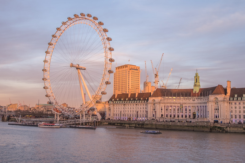 London UK - December 22 2016 : The London Eye near the River Thames in London England. The London Eye is a giant Ferris wheel on the South Bank of the River Thames in London.