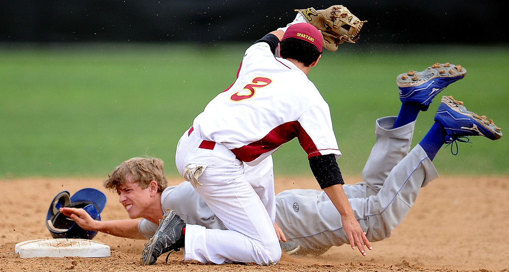 . San Marino\'s Willie Forgatch is tagged out by La Canada shortstop Clayton Herrmann (C) (3) at second base on a attempted steal in the fifth inning of a prep baseball game at La Canada High School on Wednesday, March 8, 2013 in La Canada, Calif. La Canada won 3-2.  (Keith Birmingham Pasadena Star-News)