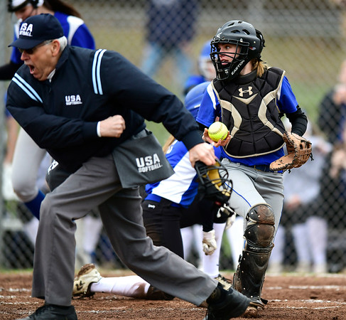 4/9/2019 Mike Orazzi   Staff Bristol Eastern's Paige McLaughlin (2) tags out Southington's Chrissy Marotto (2) during Tuesday's softball game in Bristol.