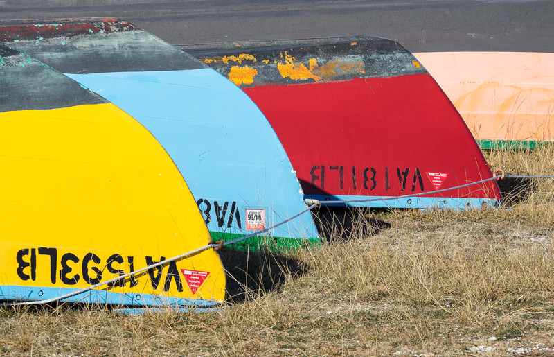 Colorful Wooden Boats Stored Upside Down for Winter