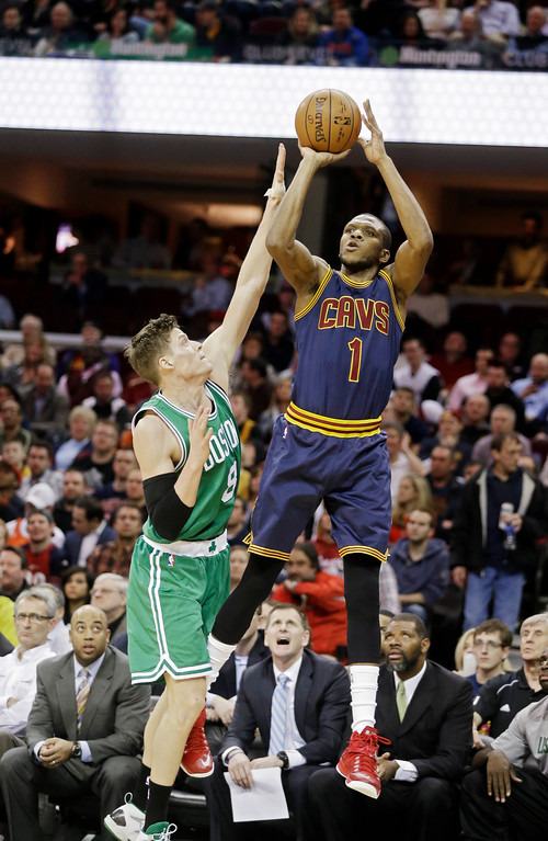 . Cleveland Cavaliers\' James Jones (1) shoots over Boston Celtics\' Jonas Jerebko, from Sweden, in an NBA basketball game Tuesday, March 3, 2015, in Cleveland. (AP Photo/Mark Duncan)