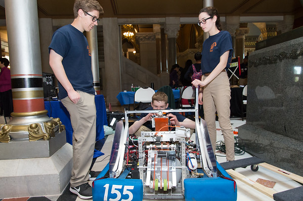04/24/19 Wesley Bunnell | Staff A Student-Manufacturer Connection Fair was held on Wednesday at the State Capitol Building connecting over 500 students and dozens of Connecticut companies to explore careers in advanced manufacturing. Members of the FIRST Robotics Program's Berlin First- The Techno-nuts look over a robot built by the program from a previous season which was designed to shoot a ball about 13 feet high into a castle wall opening. Paul Coccomo, L, Michael Bryant and Melanie Mouser.