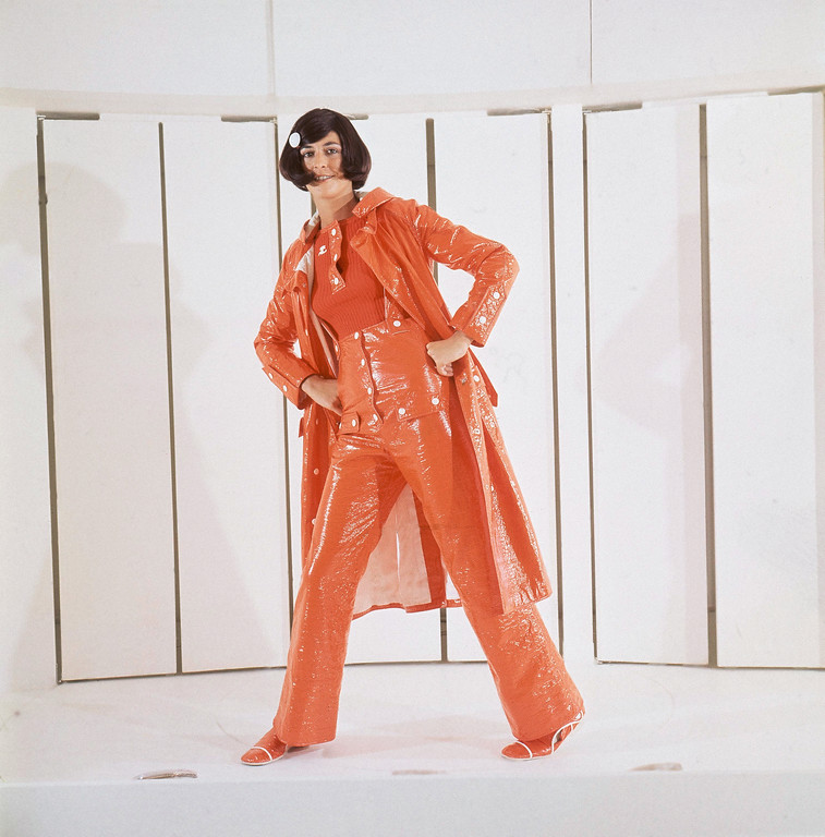 . A bright red vinyl raincoat worn over a white pullover and matching vinyl boots, August 11, 1970. A creation from the Courreges autumn and winter fashions for 1970. (AP Photo/Marqueton)