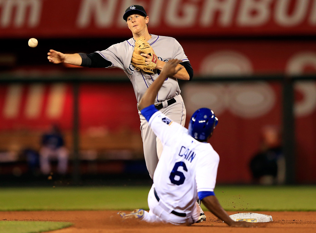 . DJ LeMahieu #9 of the Colorado Rockies attempts a double play as Lorenzo Cain #6 of the Kansas City Royals slides into second during the game at Kauffman Stadium on May 13, 2014 in Kansas City, Missouri.  (Photo by Jamie Squire/Getty Images)