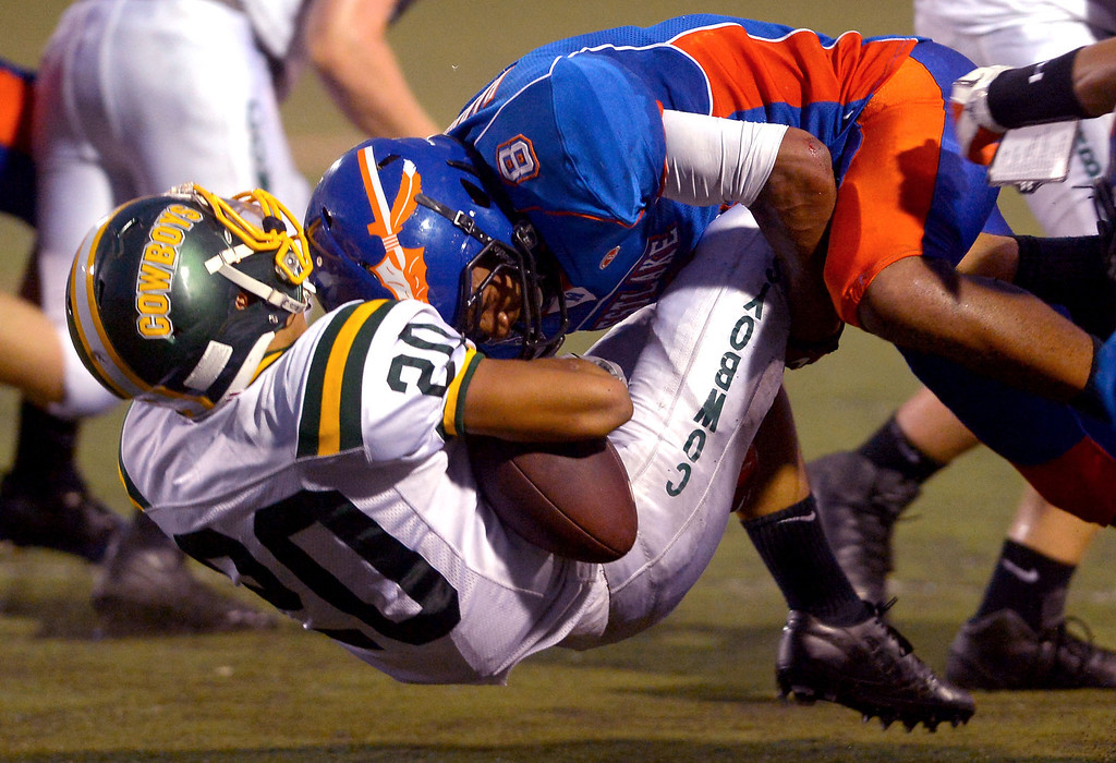 . Canyon High School\'s Liam Cabrera is brought down by Westlake\'s Jayln Harrison August 30, 2013 in Westlake Village, CA.(Andy Holzman/Los Angeles Daily News)