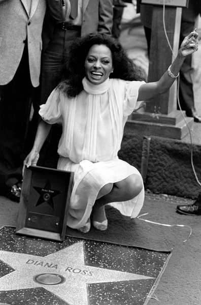 . Entertainer Diana Ross poses next to her star bearing her name on the Hollywood Walk of Fame in Hollywood, Ca., May 6, 1982.  Ross is honored with the 1,748th star on the sidewalk.  (AP Photo/Wally Fong)