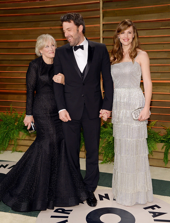 . Glenn Close, left, Ben Affleck and wife Jennifer Garner attend the 2014 Vanity Fair Oscar Party on Sunday, March 2, 2014, in West Hollywood, Calif. (Photo by Evan Agostini/Invision/AP)