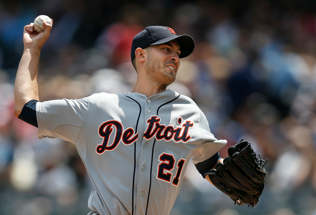 . Detroit Tigers starting pitcher Rick Porcello delivers in the first inning of a baseball game against the New York Yankees at Yankee Stadium in New York, Thursday, Aug. 7, 2014.  (AP Photo/Kathy Willens)