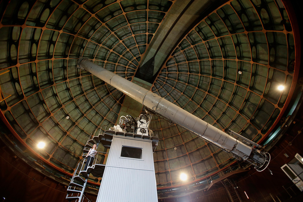 ". Astronomer Elinor Gates stands on the tower beneath the 36"" Refractor telescope at Lick Observatory east of San Jose, Calif. on Wednesday, May 8, 2013. The observatory will be celebrating its 125th anniversary.  (Gary Reyes/ Bay Area News Group)"