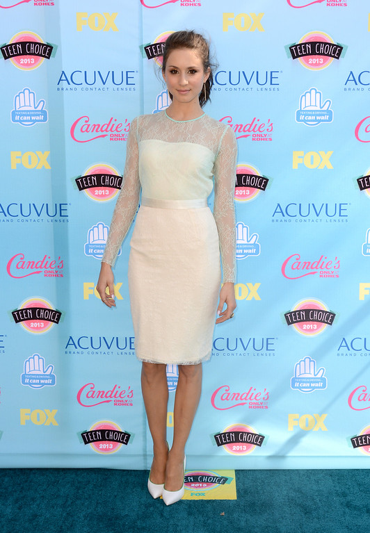 . Troian Bellisario arrives at the Teen Choice Awards at the Gibson Amphitheater on Sunday, Aug. 11, 2013, in Los Angeles. (Photo by Jordan Strauss/Invision/AP)