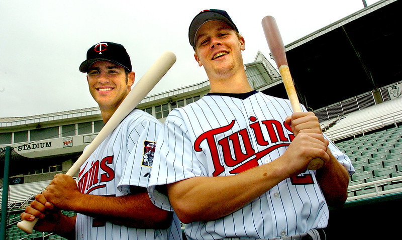 . The Twins\' Joe Mauer, left, and Justin Morneau pose after a workout at the Lee County Sports Complex on March 3, 2005.