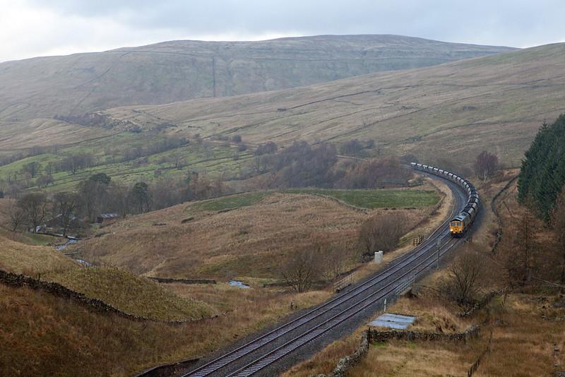 Freightliner coal train approaching Blea Moor tunnel in the rain.