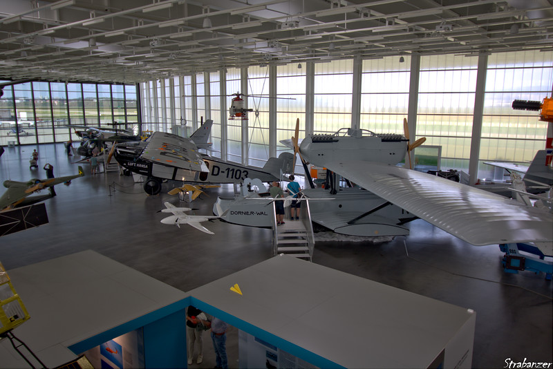 The main hall with Dornier Wal flying boat and  Merkur in the background. Dornier Museum, Friedrichshafen.   08/24/18 This work is licensed under a Creative Commons Attribution- NonCommercial 4.0 International License.
