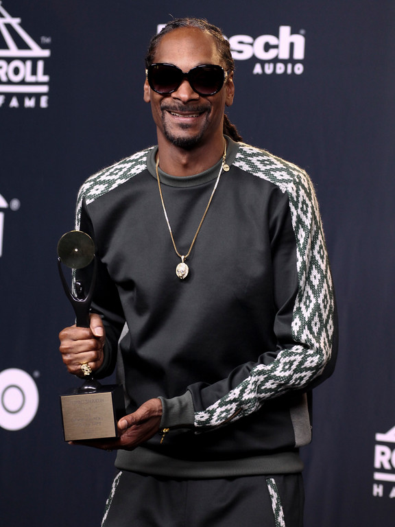 . Snoop Dogg poses with an award given posthumously to Tupac Shakur in the 2017 Rock and Roll Hall of Fame induction ceremony press room at the Barclays Center on Friday, April 7, 2017, in New York. (Photo by Andy Kropa/Invision/AP)