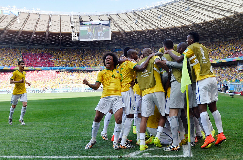 . Brazilian players celebrate after Brazil\'s opening goal during the World Cup round of 16 soccer match between Brazil and Chile at the Mineirao Stadium in Belo Horizonte, Brazil, Saturday, June 28, 2014. (AP Photo/Martin Meissner)