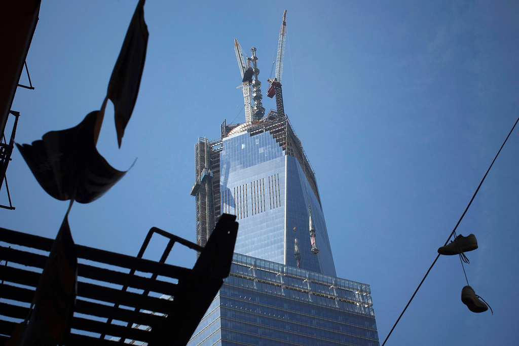 . The final pieces of the spire for One World Trade Center are hoisted in New York, May 2, 2013. Crane operators hoisted the final pieces of the spire atop One World Trade Center on Thursday, helping to fill the void in the New York City skyline that was left by the attacks of Sept. 11, 2001. REUTERS/Shannon Stapleton
