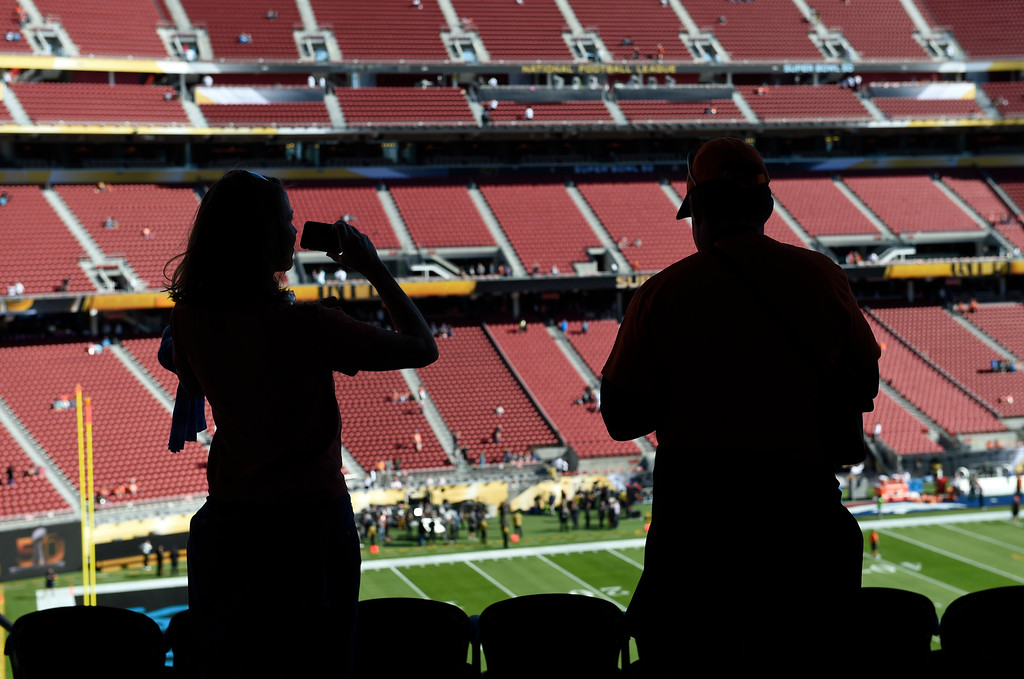 . SANTA CLARA, CA - FEBRUARY 7: Cindy Miner Kapelke (L) and her husband Chuck Kapelke (R) formerly of Denver, CO now of Alameda, CA takes photos of the stadium and field prior to the start of the game.  The Denver Broncos played the Carolina Panthers in Super Bowl 50 at Levi\'s Stadium in Santa Clara, California on February 7, 2016. (Photo by RJ Sangosti/The Denver Post)
