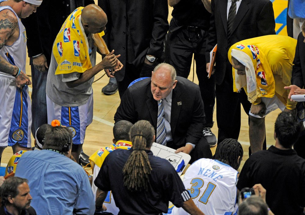 . Denver Nuggets head coach George Karl talks to his team during time out in the second quarter of play  vs the Los Angeles Lakers in Game 3 of the Western Conference Finals best of seven series Saturday May 23, 2009 at  the Pepsi Center.  Joe Amon, The Denver Post